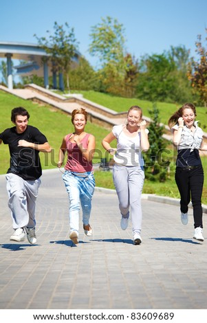 High school students running in park