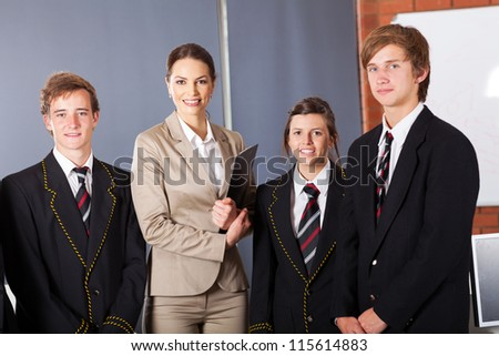 high school teacher and group of students in classroom