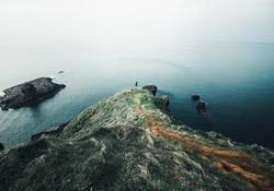 High sea cliffs stand above the vast ocean