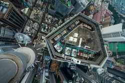 High skyscrapers, office buildings in Hong Kong city, China, top view from Manulife Plaza