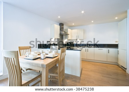 high spec dining area with open plan kitchen view #38475238