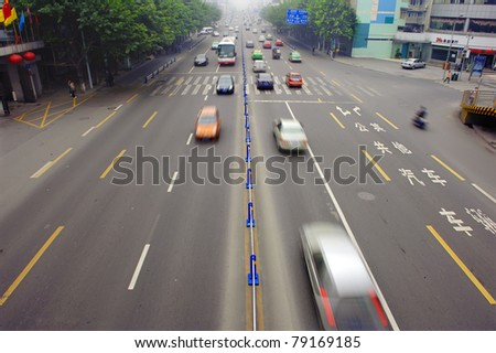 High speed and blurred traffic trails in downtown #79169185