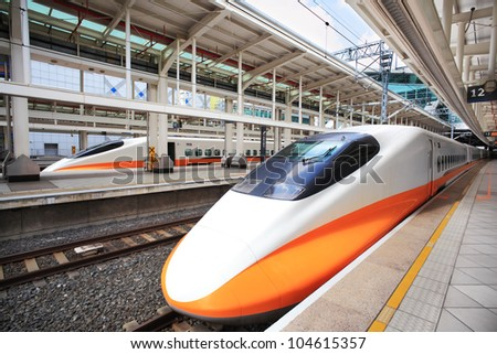 High speed bullet train by the railway station #104615357