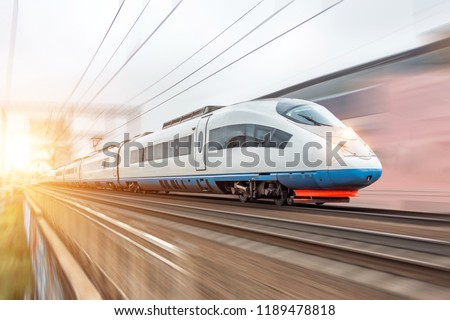 High speed fast train passenger locomotive in motion at the railway station city #1189478818