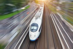 High speed fast train passenger locomotive railroad travel motion blur effect in the city, top aerial view above