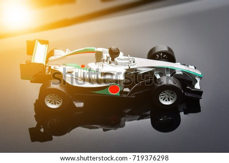 High-speed, high-speed racing is like the power of excellent driving. Stand still on the background, stand out and powerful.High-speed racing car with excellent driving performance with the power  #719376298