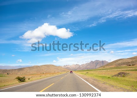 High-speed highway leading to a mountains range