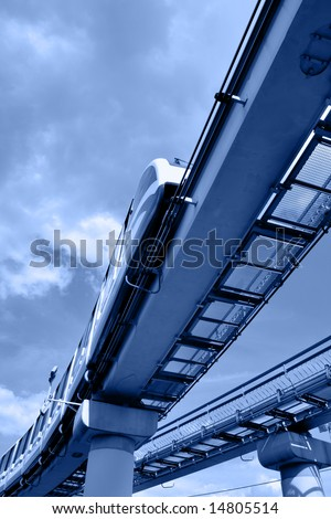 High speed monorail train on overpass toned in blue color