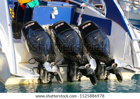High-speed pleasure boat with three outboard motors of 250 horsepower each. Modern sightseeing boat with powerful engines and stainless steel propeller. Chalong Bay Marina, Phuket island, Thailand #1525886978