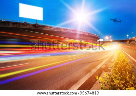 High speed traffic and blurred light trails under the overpass at night scene