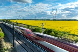 high-speed train crossing a countryside in France