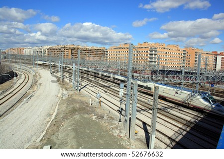 High speed train leaving the city - stock photo