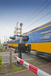 high speed train passing a railroad crossing in the Netherlands