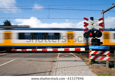 High speed train passing a railway crossing