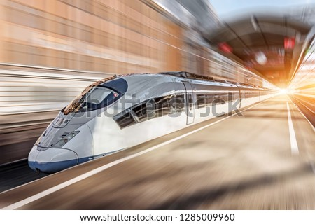 High speed train passing near the passenger station #1285009960