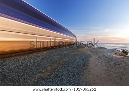 High Speed Train passing through Del Mar Heights along Pacific Coastline in San Diego County Southern California