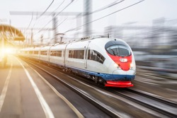 High speed train rides at high speed at the railway station in the city
