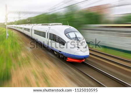 High speed train rides at high speed at the railway station in the city #1125010595