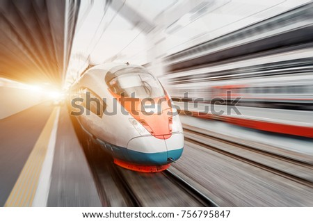 High speed train rides at high speed at the railway station in the city #756795847