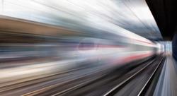 High speed train runs on rail tracks . Train in motion