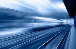 High speed train runs on rail tracks - Train in motion