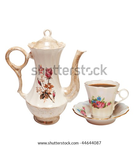 high teapot and cup. Isolated on white, with clipping path.