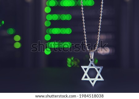 High tech and Jewish religious symbol on a bokeh background from lamps of server equipment Foto stock ©