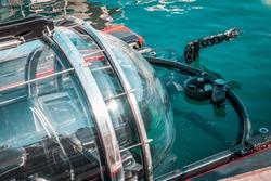 High tech mini submarine, preparing for underwater biology research. Marine life, seeking fish species and water data.