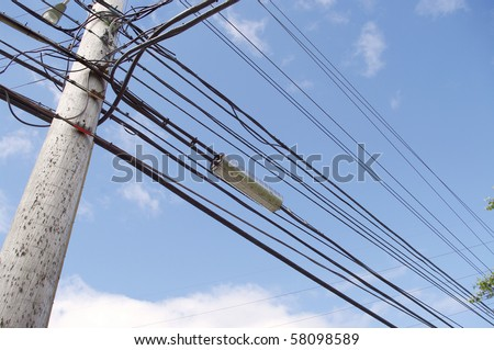high tension hydro power electricity cable lines live wire overhead with sky background