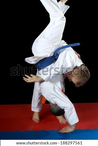 High throw uki-goshi in the performance athlete with orange belt