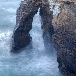 High tide and big waves between the stone arches of the beach of As Catedrais, Ribadeo Lugo, Galicia