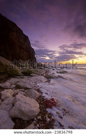 High tide at sunset at the base of the cliffs in Hunstanton, Norfolk, England