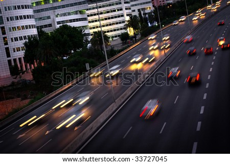 High traffic road with motion blurred automobile in a rush-hour