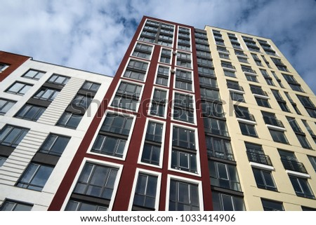 High up modern apartment building on a background of cloudy blue sky in a residential district of Lviv city, Ukraine