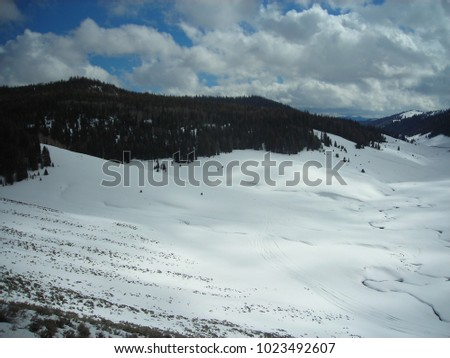 High up view of winding roads and a fantastic wintry landscape. #1023492607