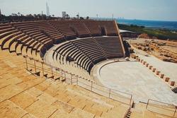 High view looking into Caesarea Amphitheater, ocean in distance, Israel