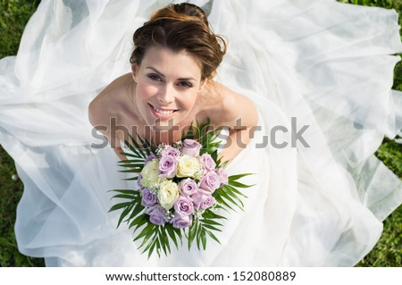 Shutterstock High View Portrait Of Beautiful Happy Bride Sitting On The Grass