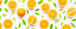 High vitamin C, Juicy and sweet. Fresh orange fruit with green leaves  on white background. Top view