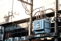 High voltage AC power transformer, connected with wires and cables, maintaining a stable voltage inside the city and metro area