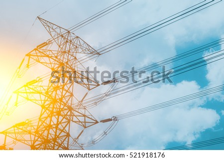 High voltage cable power post steel tower pylons in sunset scene twilight vintage color tone.