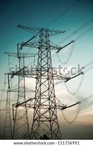 high voltage cable pylon on blue sky background
