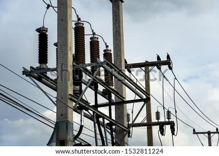 High voltage cables with electrical insulator and electrical equipment in power substation.