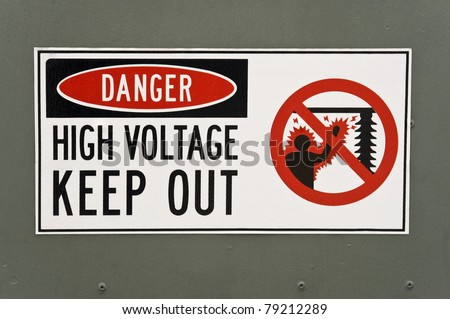 High Voltage Danger Sign Painted on the Metal Surface of a Transformer