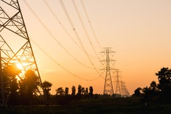 High voltage electric pole at sunset,silhouette style.