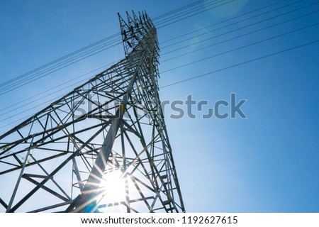 High voltage electric tower in the blue sky white cloud backgrou