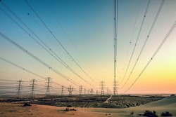 High voltage electric tower on sunrise time near Al Hofuf -Saudi Arabia.