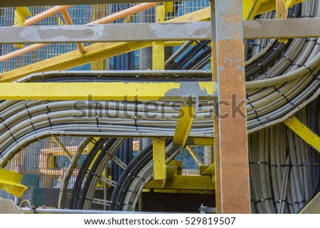 High voltage electrical cables on cable tray with unfinished painting structure.