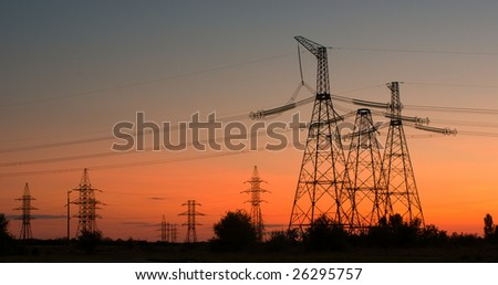 High-voltage electrical tower on sunset