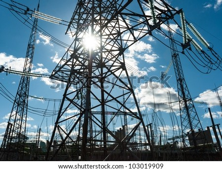 High voltage electrical  towers against blue sky