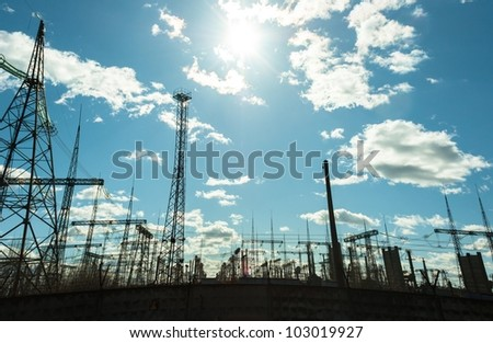 High voltage electrical  towers against blue sky #103019927